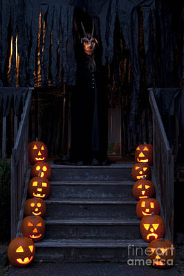 Travel Rights Managed Images - Haunted House with Lit pumpkins and Demon Royalty-Free Image by Jim Corwin