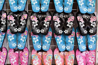 Repetition Photograph - Hawaiian Flip Flop Display At Market by Daisy Gilardini