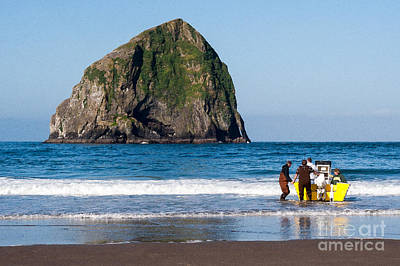 Photograph - Haystack Rock And Dory Fishermen by Margaret Hood
