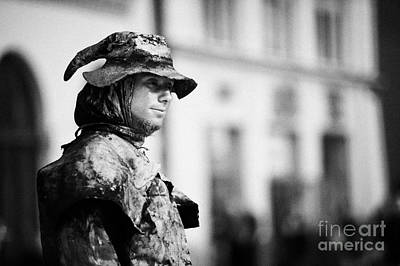 Cracovia Photograph - Head And Shoulders Of Man Dressed As A Gold Statue Street Entertainer In Rynek Glowny Town Square Krakow by Joe Fox