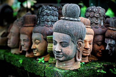 Heads Of Statues Of Buddha Are Stacked Art Print by Matt Brandon
