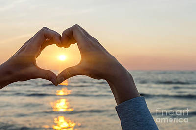 Heart Wall Art - Photograph - Heart Shaped Hands Framing Ocean Sunset by Elena Elisseeva