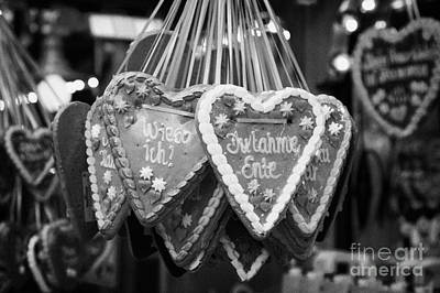 heart shaped Lebkuchen hanging on a christmas market stall in Berlin Germany Art Print by Joe Fox