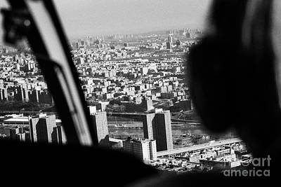 Helicopter Flies Over Harlem And East River New York City Art Print by Joe Fox