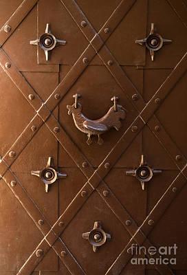 Photograph - Hen Shaped Doorknob On A Brown Metal Doors by Jaroslaw Blaminsky