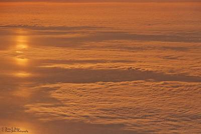 Photograph - High Above The Clouds  by Hany J