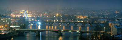 Vltava Photograph - High Angle View Of A Bridge At Dusk by Panoramic Images
