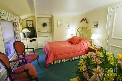 Photograph - High End Hotel Bedroom With Flowers. by Don Landwehrle