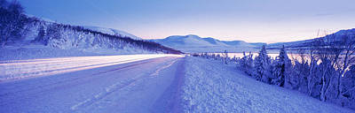 Highway Running Through A Snow Covered Art Print by Panoramic Images