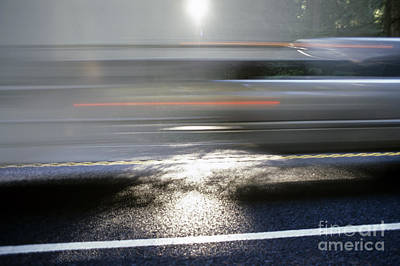 Photograph - Highway With Motion And Blurred Cars Through Sunlight And Reflec by Jim Corwin