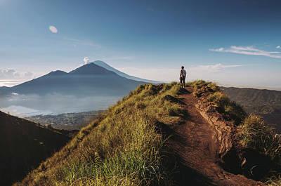 Hiker Staying On Top Of  Mount Batur Art Print by Alex Grabchilev / Evgeniya Bakanova