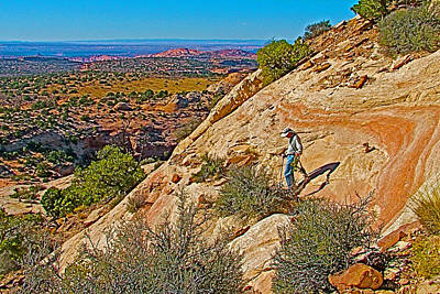 Hiking Down Steep Slickrock Of Aztec Butte Trail In Island In The Sky In Canyonlands Np-utah Art Print by Ruth Hager