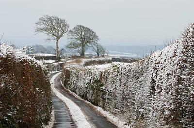 Leaden Sky Photograph - Hill Top Lane In Snow by Pete Hemington
