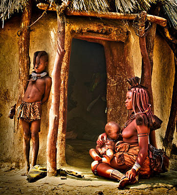 Himba Family By The Door Of Their Clay Hut Art Print by Paul W Sharpe Aka Wizard of Wonders