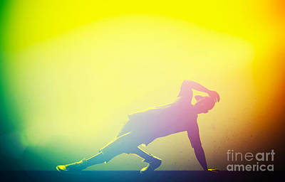 Action Photograph - Hip Hop Break Dance Performed By Young Man In Colorful Club Lights by Michal Bednarek