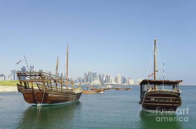 Photograph - Historic Dhows And Doha Skyline by Paul Cowan