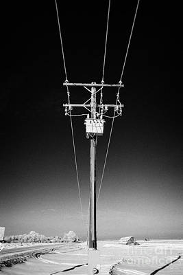 hoar frost covered overhead electricity transmission lines and pole transformer rural Canada Art Print by Joe Fox