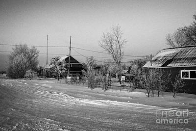 hoar frost covered street in small rural village of Forget Saskatchewan Canada Art Print by Joe Fox