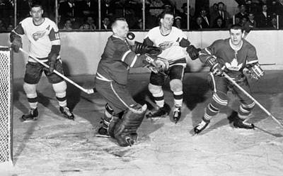 Toronto Maple Leafs Photograph - Hockey Goalie Chin Stops Puck by Underwood Archives