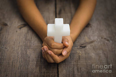 Rosaries Photograph - Holding A Religious Cross by Aged Pixel