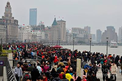 Bicycle Graphics - Holiday crowds throng the Bund in Shanghai China by Imran Ahmed