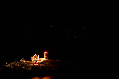 Photograph - Holiday Lights At Nubble Light by Jeff Sinon