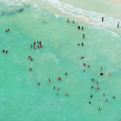 Water Photograph - Holiday Makers Cooling Off In The Sea by Tommy Clarke
