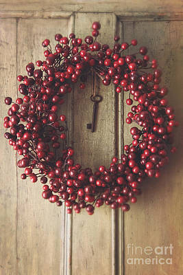 Photograph - Holiday Wreath Hanging On Old Wood Door by Sandra Cunningham