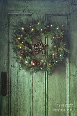 Photograph - Holiday Wreath On Old Wooden Door by Sandra Cunningham
