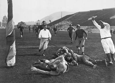 Laying Down Photograph - Hollywood Football Touchdown by Underwood Archives