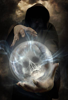 Hooded Man Wearing Dark Cloak Holding Glowing Crystall Ball With Human Skull Image Inside Print by Jaroslaw Blaminsky