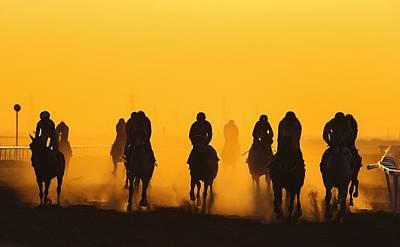 Horse Racing Against Clear Orange Sky Art Print by Bob Mccaffrey / Eyeem