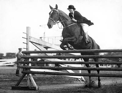 Domestic Animals Photograph - Horse Taking Jump by Underwood Archives