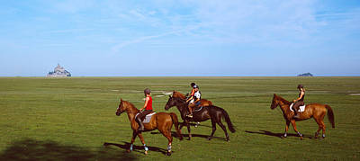 Horseback Photograph - Horseback Riders In A Field With Mont by Panoramic Images