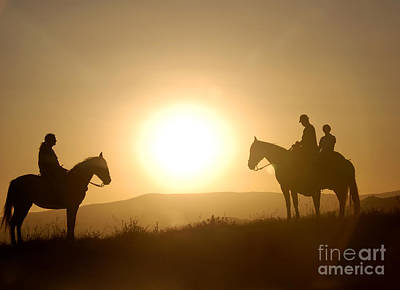Horseriders At Sunset Art Print by Richard Fairless