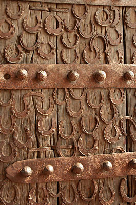 Metalwork Photograph - Horseshoes Decorate A Wooden Door, Jama by Inger Hogstrom
