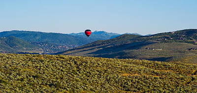 Hot Air Balloon Photograph - Hot Air Balloon Flying In A Valley by Panoramic Images