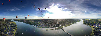 Richelieu Photograph - Hot Air Balloons Flying Over A River by Panoramic Images