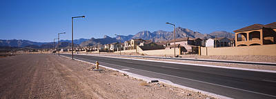 In A Row Photograph - Houses In A Row Along A Road, Las by Panoramic Images