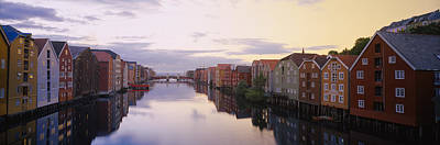 Houses On Both Sides Of A River Art Print by Panoramic Images