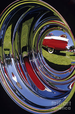 Photograph - Hub Cap Reflection Antique Car by Jim Corwin