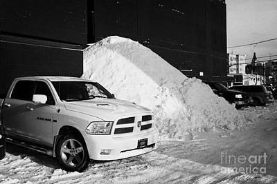 huge pile of snow cleared from parking lot in Saskatoon Saskatchewan Canada Art Print by Joe Fox