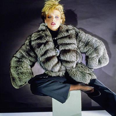 Cross Legged Photograph - Hunter Reno Wearing A Grosvenor Canada Fur Coat by Horst P. Horst