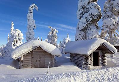 Huts In Forest After Heavy Snowfall Art Print by Science Photo Library