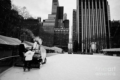 ice clearer and assistants clearing the ice at Bryant Park ice skating rink new york Art Print