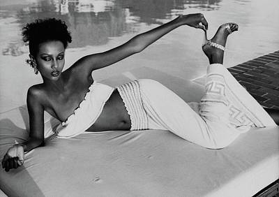 Iman Wearing A Yves Saint Laurent Skirt Art Print by Kourken Pakchanian