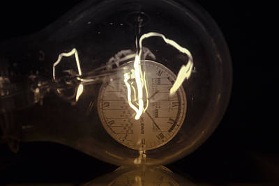 Photograph - Incandescent Light Bulb With A Mechanic Raketa Watch Close-up by Vlad Baciu