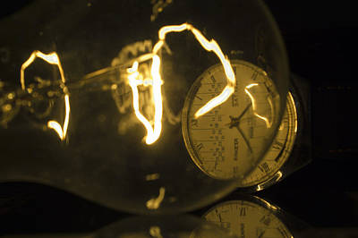 Photograph - Incandescent Light Bulb With A Raketa Watch Close-up by Vlad Baciu