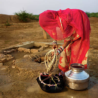 Traditional Clothing Photograph - Indian Woman Getting Water From The by Hadynyah