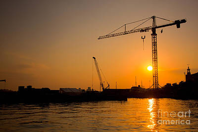 Trade Photograph - Industrial Harbor At Sunset And A Crane by Michal Bednarek